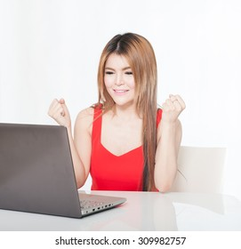 laptop woman happy. Asian girl sitting with laptop computer notebook smiling isolated on white background.