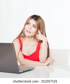 laptop woman happy. Asian girl sitting with laptop computer notebook smiling on white background.