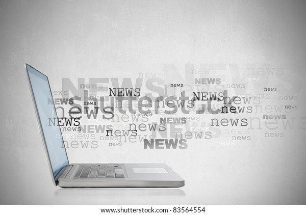Laptop with the word news coming out of the screen