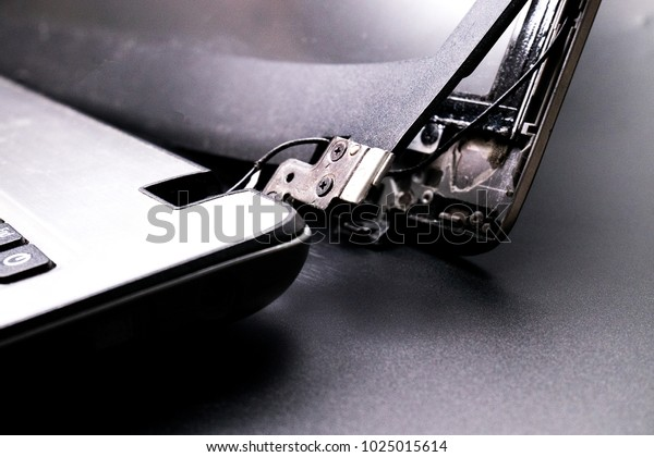 Laptops are broken with a broken hinge on the screen
