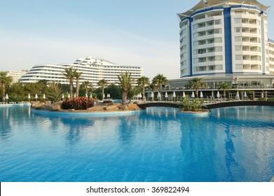 Lara, ANTALIA, TURKEY - MAY 17, 2007: The big swimming-pool and terrain of Anatolian high class hotel Lares in Turkey .
