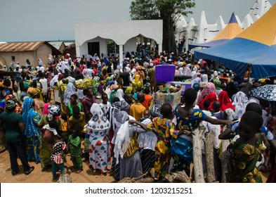 Larabanga, Ghana. September the 19th 2018. A crowd at Fire Festival (Bugum Chugu), bringing out the Quran in front of Larabanga Mosque.