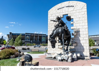 "Laramie, WY, USA - September 28, 2019: ""Breakin' Through"" Bronze Statue at War Memorial Stadium at the University of Wyoming"