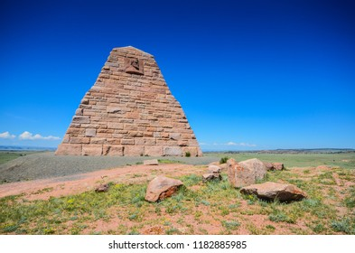 Laramie, Wyoming / USA - July 16, 2013: The Ames Monument is a large pyramid in Albany County, Wyoming, designed by Henry Hobson Richardson and dedicated to brothers Oakes Ames and Oliver Ames, Jr.