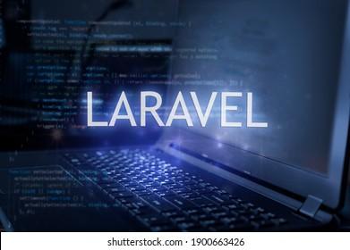 Laravel inscription against laptop and code background. Technology concept.