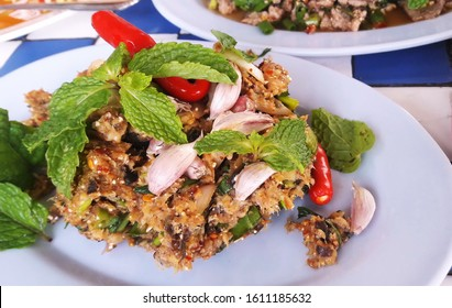 Larb Pla Duk,Catfish Salad, a popular Thai food using grilled catfish meat mixed with herbs and spices. northeastern Thai food.