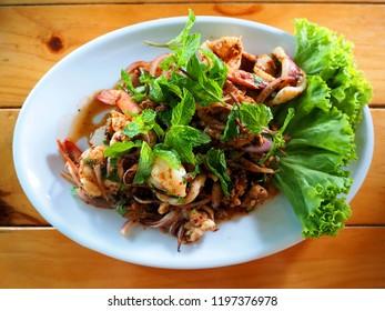 Larb talay is spicy seafood salad E-san (northeast), Thai style. Thai traditional food.