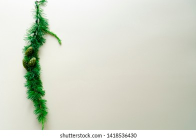 Larch branch with green cones on a yellow background. Christmas tree with a pine cone. flat flay, copy space, isolated.