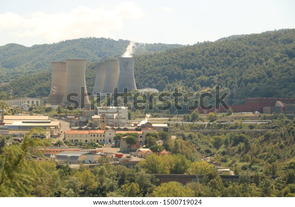 Larderello, Tuscany, Italy. About september 2019. Geothermal power plant for electricity production. Condensation towers in reinforced concrete.