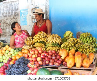 Laredo, Peru - January 28, 2017: Two women chat while selling fruit at market in Laredo, Peru on January 28, 2017