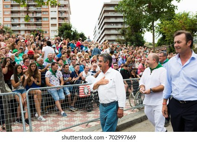 LAREDO, SPAIN - AUGUST 05, 2017: Miguel Angel Revilla Roiz, president of Cantabria, greets the public in the parade of floats in the battle of flowers of Laredo, Cantabria, Spain