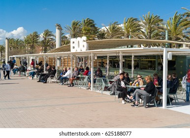 L'ARENAL, SPAIN - MARCH, 2017: Tourists having a drink at famous balneario no. 6 on Mallorca island
