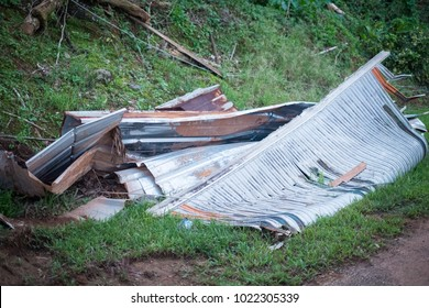 Lares, Puerto Rico / United States: Dec 4 2017: What remains of a roof lies aside the raod waiting for pickup.