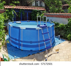 large above ground metal frame swimming pool in my back yard