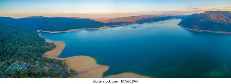 Large aerial panorama of beautiful lake in mountains at sunset