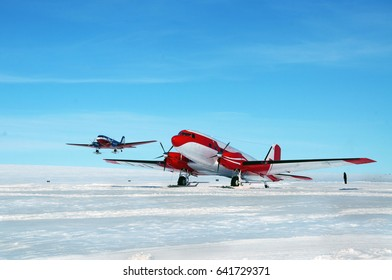 Large aircraft tunes snow on the runway airport. Antarctic