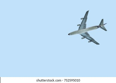 Large airplane belly (4 engines) isolated on light blue sky