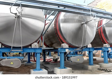 Large aluminum drums tanks and pipelines modern plant for the production of wine food industry. Fermentation tanks fragmentation of wine with grape juice