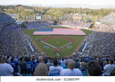 Large American Flag during opening ceremony of National League Championship Series (NLCS), Dodger Stadium, Los Angeles, CA on October 12, 2008