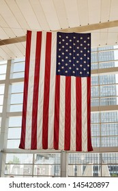 Large American flag vertically inside a building