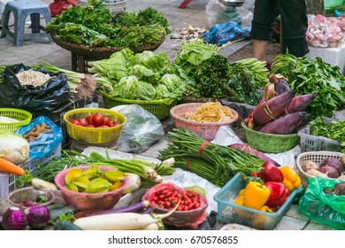 Large amounts of vegetables on display at a stall in Hanoi, Vietnam.