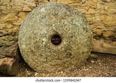 Large ancient stone millstone