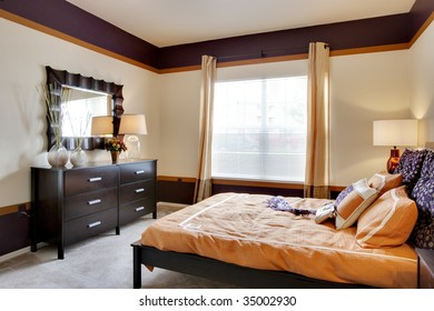 Large apartment bedroom with brightly lit window