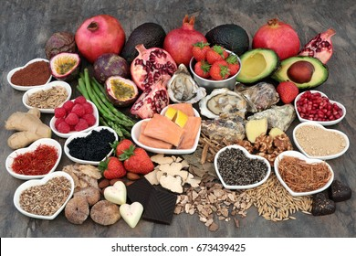 Large aphrodisiac super food selection for good sexual health over marble background.