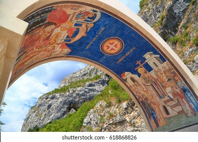 Large arch decorated with religious scenes above the gate to Ostrog Monastery, Montenegro