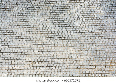 A large area, laid out of paving stone. Background texture relief.