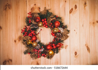 Large artificial circled wreath during Christmas on door