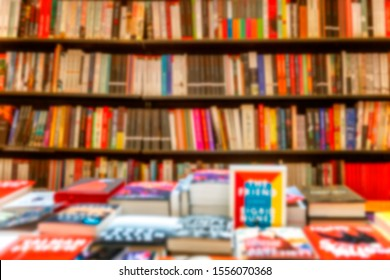 A large assortment of books on shelves in a bookstore. Blurred. Background. Space for text.