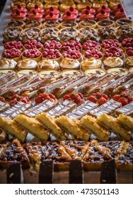 Large assortment of mini cakes, muffins and pastries  at Borough Market in London, UK