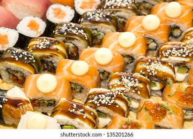 large assortment of sushi, fish and eggs at a Japanese restaurant
