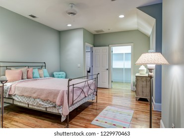 Large attic bedroom with hard wood floors and walk in closet