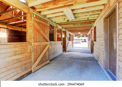 Large and authentic horse barn with many stalls.