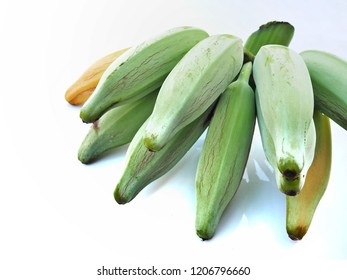 Large banana skin on a white background. Green effect and some yellow effect. It can be eaten. The scientific name is Musa ABB group.