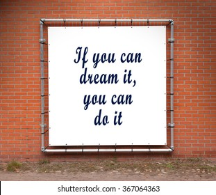 Large banner with inspirational quote on a brick wall - If you can dream it, you can do it
