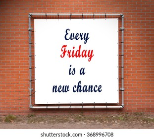 Large banner with inspirational quote on a brick wall - Every friday is a new chance