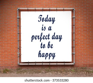 Large banner with inspirational quote on a brick wall - Today is a perfect day to be happy