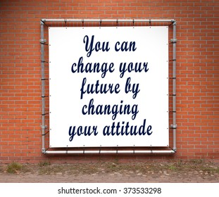 Large banner with inspirational quote on a brick wall - You can change your future...