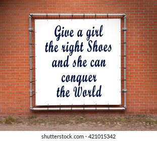Large banner with inspirational quote on a brick wall - Give a girl the right shoes