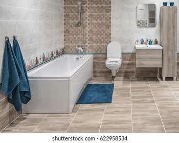 Large bathroom in a modern style, straight laconic forms, natural materials, wall and flor decoration with tiles.