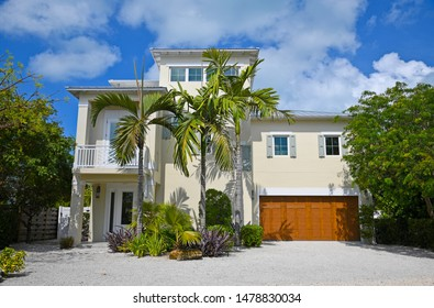 Large Beach House with deck, garage and beautiful landscaping including Palm Trees. Would Make a Great Vacation Rental.
