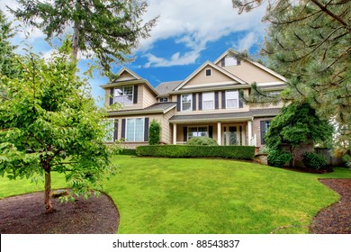 Large beautiful home with green grass