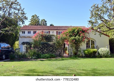 Large beautiful home with green lawn in Los Angeles, CA.