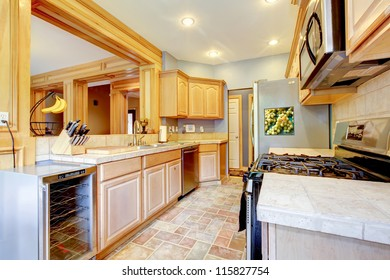 Large beautiful wood kitchen with grey and maple.