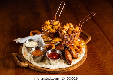 Large beer plate  on the wooden background