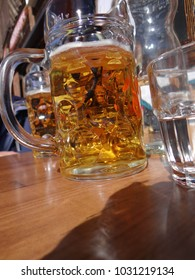 Large beer and water glasses at a small outdoor restaurant in the Portes du Soleil town of Avoriaz, France