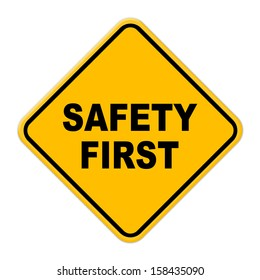 Large beveled yellow safety first road sign on white background